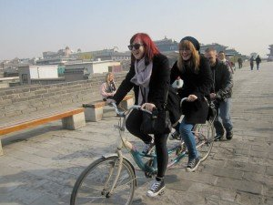 Study abroad students riding randem bikes in China.