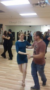 study abroad student dances salsa instructor