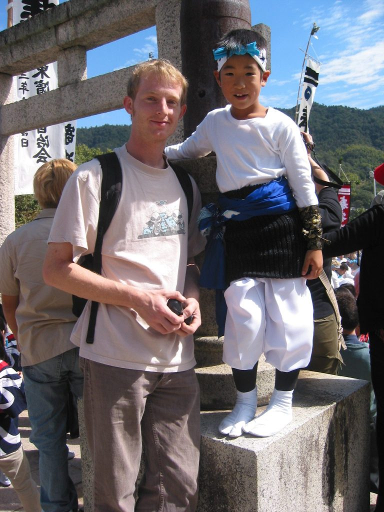 Hiroshima Marcus and a kid (Jeff Urmston) pd