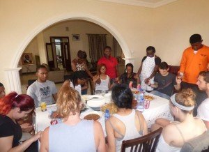 accra ghana cuisine workshop - Alicia Boone (Lincoln Univerity) saying grace