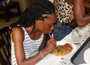 accra ghana cuisine workshop - alicia boone (Lincoln University) enjoying her meal