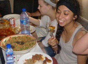 accra ghana cuisine workshop - shaneli agustin-jacinto (University of Nevada, Reno) enjoying some plantain and fried rice