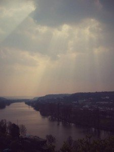sunlight breaking through the clouds over prague