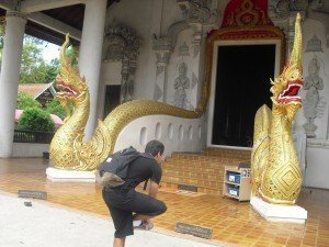 Student entering buddhist temple