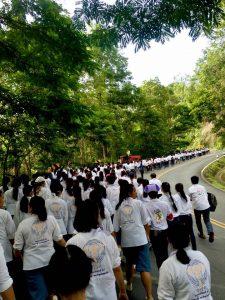 Chiang Mai University students begin the walk to Doi Suthep.