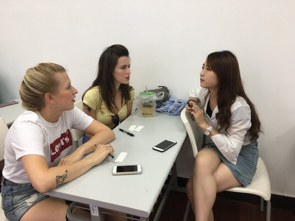 Students in China talking with language partner