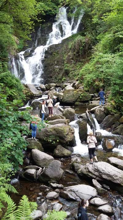 Climbing waterfall during USAC Cork optional tour to Ring of Kerry