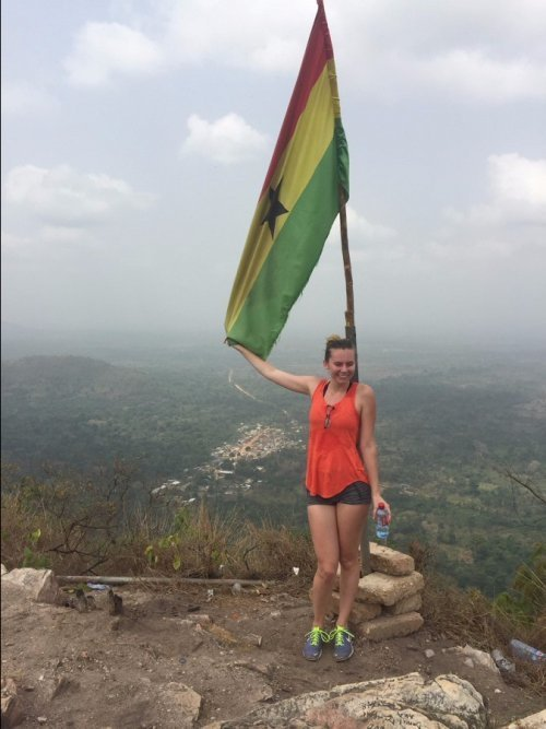 Posing with the Ghanaian flag