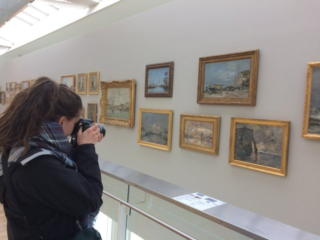 Taking pictures of rocks of Etretat at museum