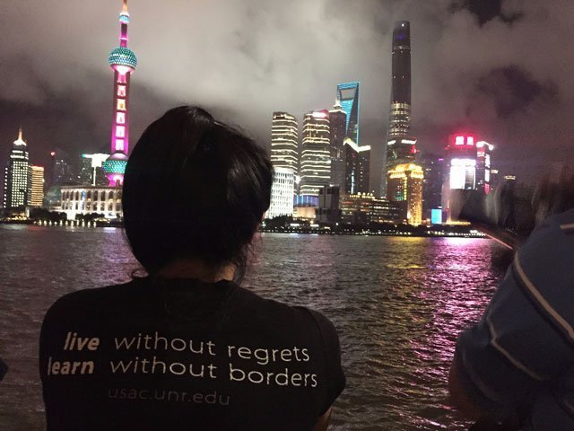 A student overlooks the city of Shanghai during a study abroad with USAC