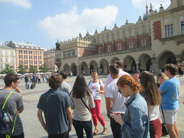Students gather in the main plaza in Krakow during an education abroad experience with USAC
