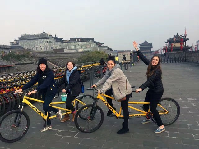 Students riding bikes on the Xi'an optional tour
