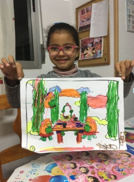 Drawing with local children during service learning in Alicante, Spain