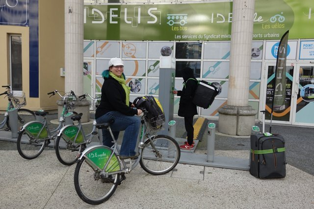Dominique renting a city bike