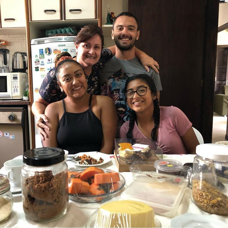 A student enjoys dinner with their host family in Floripa, Brazil