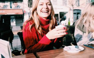 Writer, Emma Epperly, having coffee in the centre of Pau