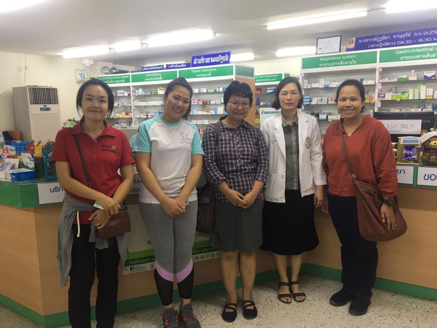The Resident Director in Thailand, Jum and local professors at a local pharmacy