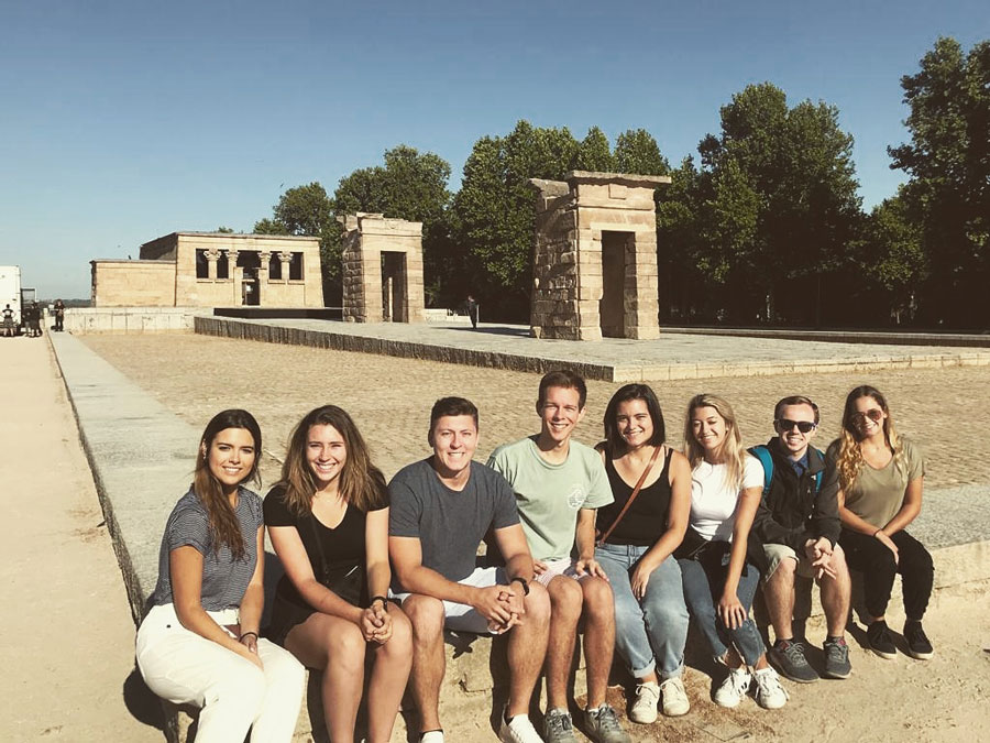 USAC Madrid students take a tour of the city and stop to take a group photo in front of the Egyptian Temple
