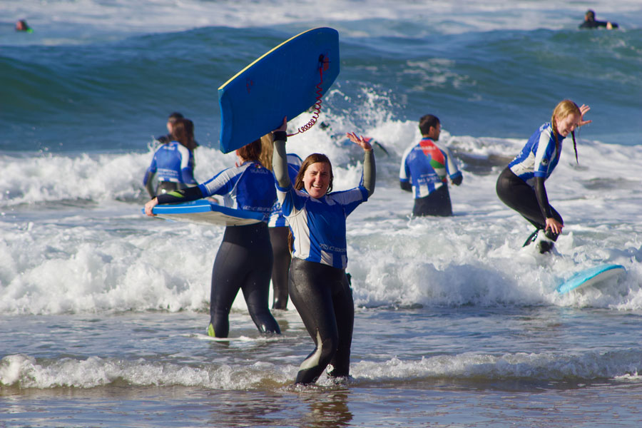 Students learn from local surfing professionals how to surf during their study abroad term in San Sebastián, Spain