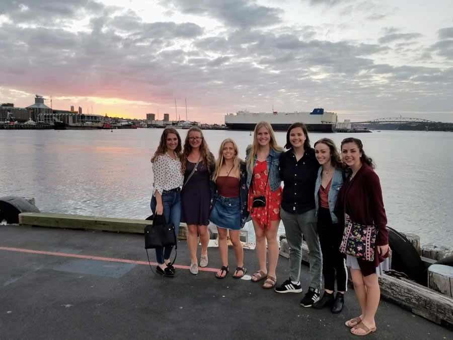 Study abroad students take a picture at the wharf in Auckland, New Zealand