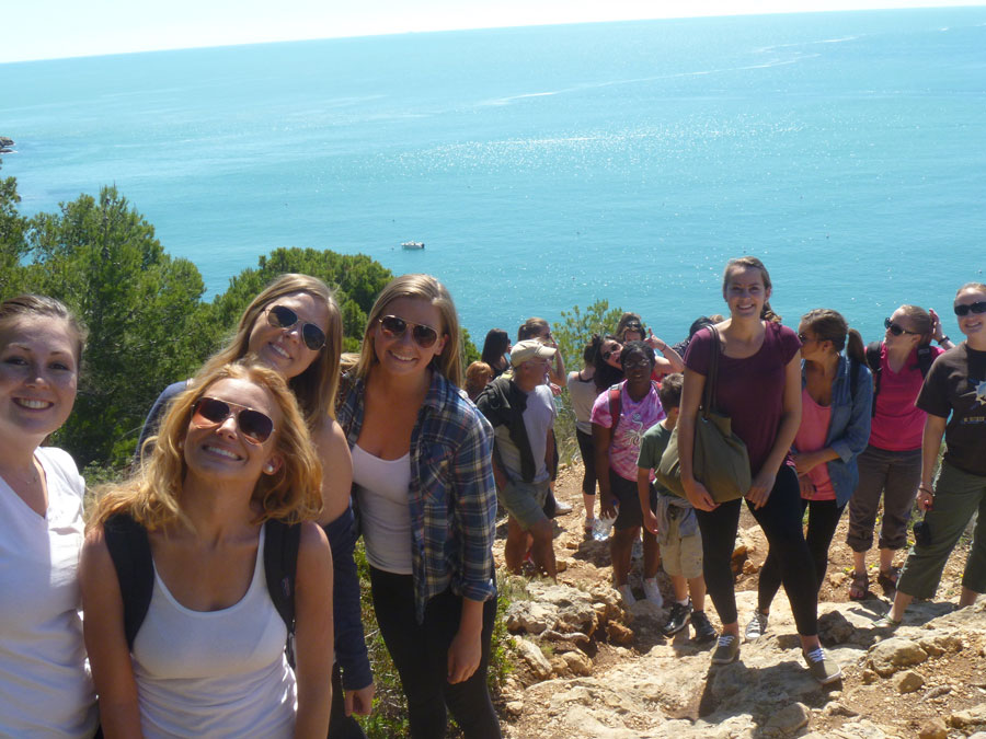 Students hiking along the ocean in Javea
