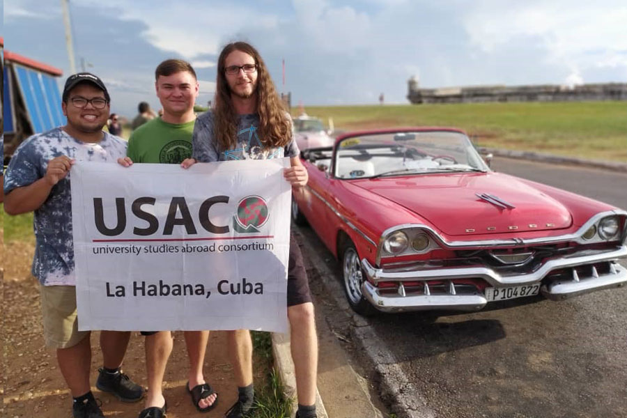 Ryan Bourgoin (right) and his classmates travel around Cuba during a study abroad trip.