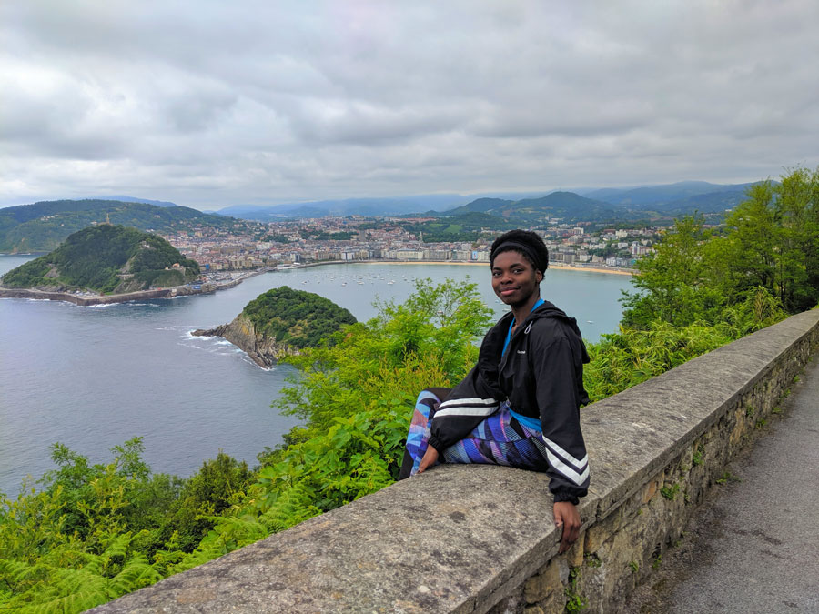 Student poses in San Sebastian, Spain during a study abroad with USAC