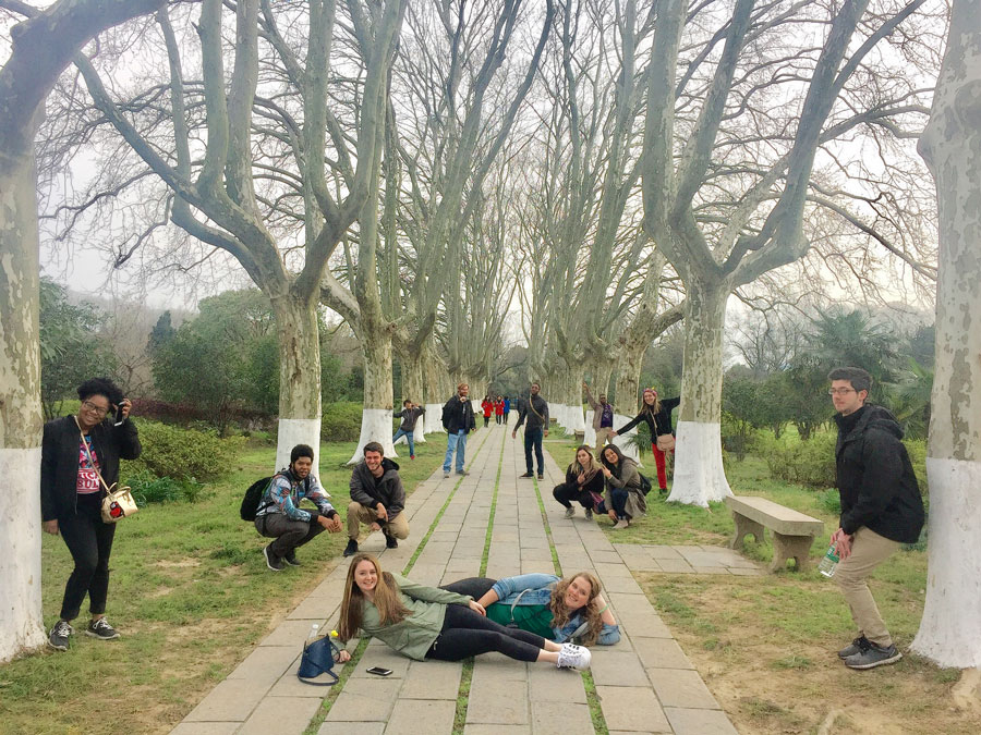 A group of students pose in Nanjing, China during a study abroad field trip with USAC