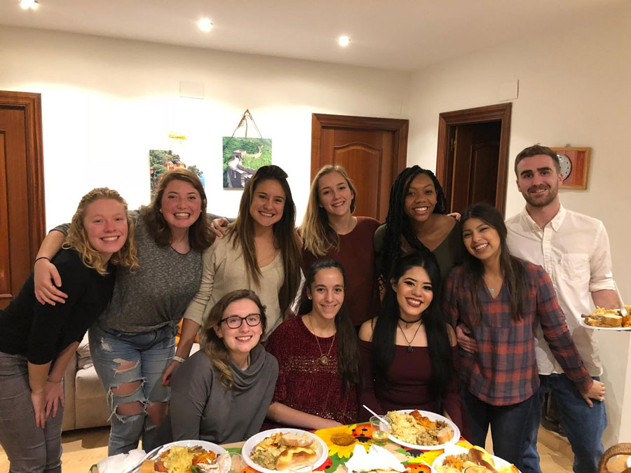 USAC students gather for a meal in Spain during a study abroad