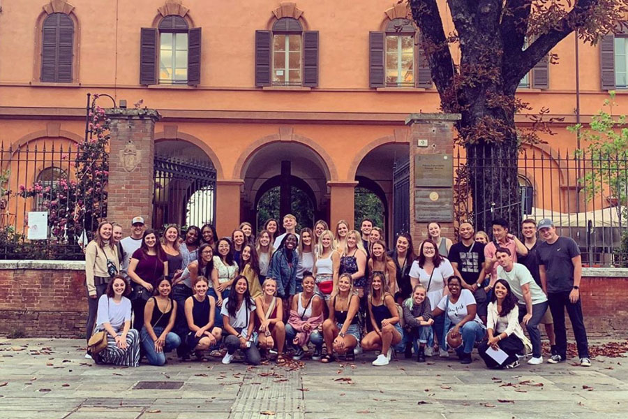 USAC students pose in Reggio Emilia during a study abroad