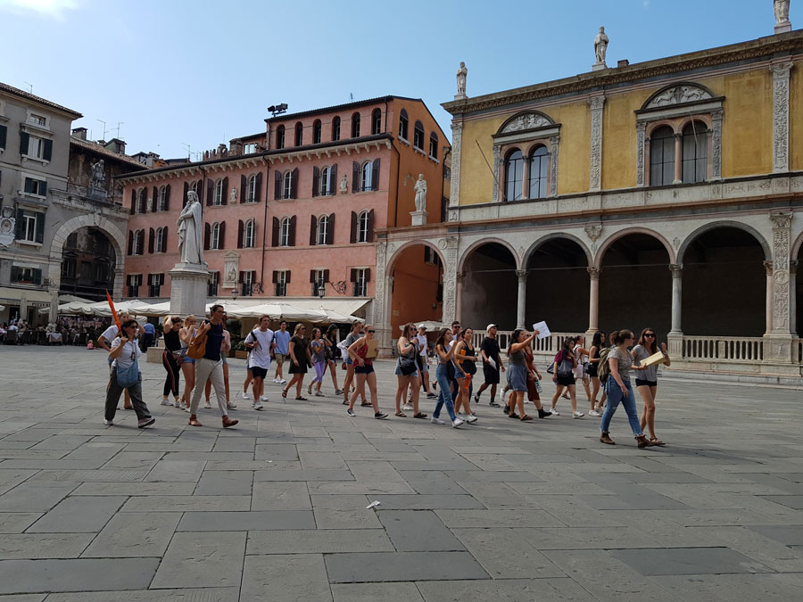 USAC students doing a walking tour of Verona during orientation to study abroad