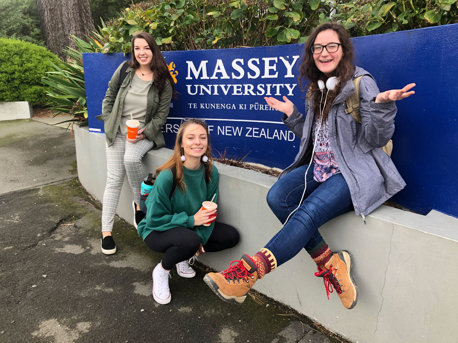 USAC New Zealand students pose in front of Massey University sign