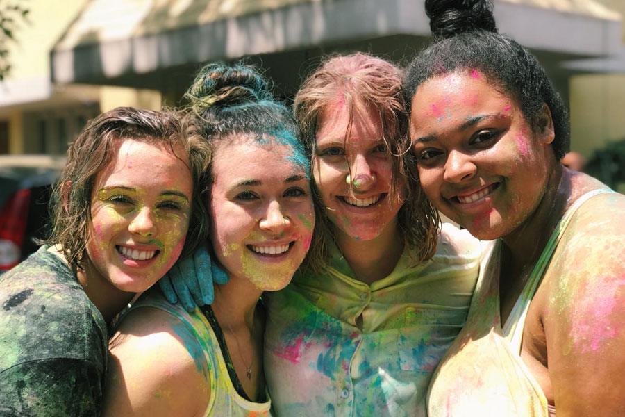 Study abroad students pose for a photo during Holi Festival in Bengaluru, India during USAC study abroad program