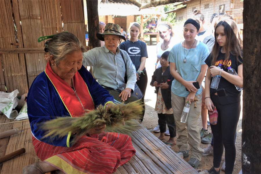 Students learn about making a broom from locals during the Hill Tribe Field Study