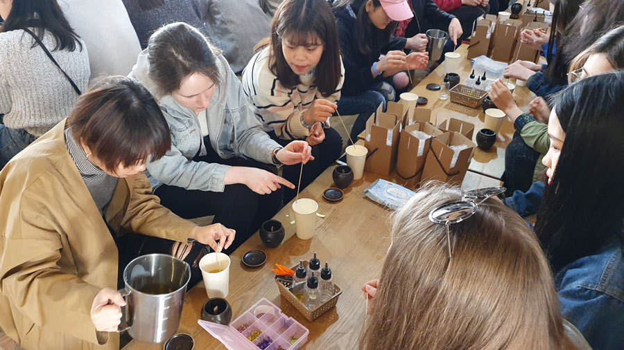 Study abroad students participate in Candle Making activity in a local Folk Village in Seoul South Korea during a study abroad with USAC