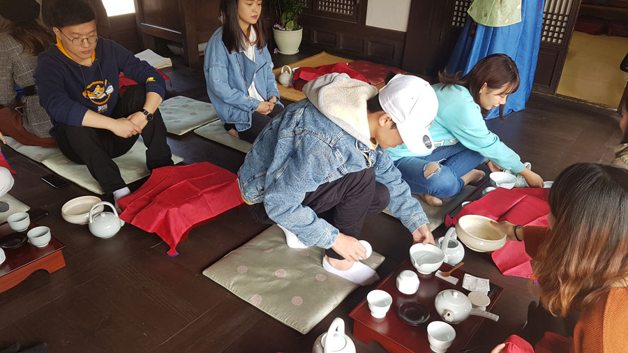Students participate in Tea Etiquette class in Seoul during study abroad in Seoul with USAC