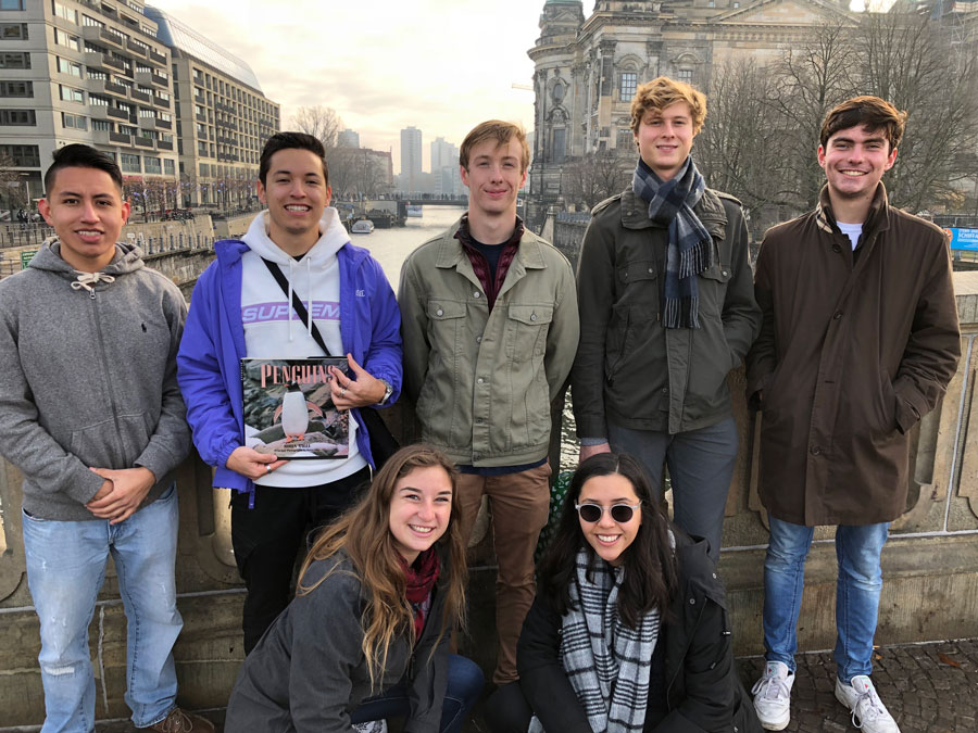 A group of students pose in front of a river during study abroad in Bilbao, Spain
