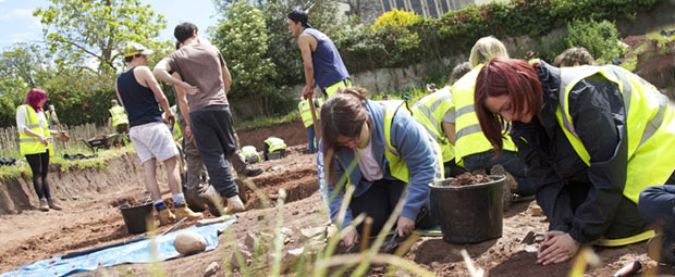 Students help plant trees in Bristol, England during a study abroad