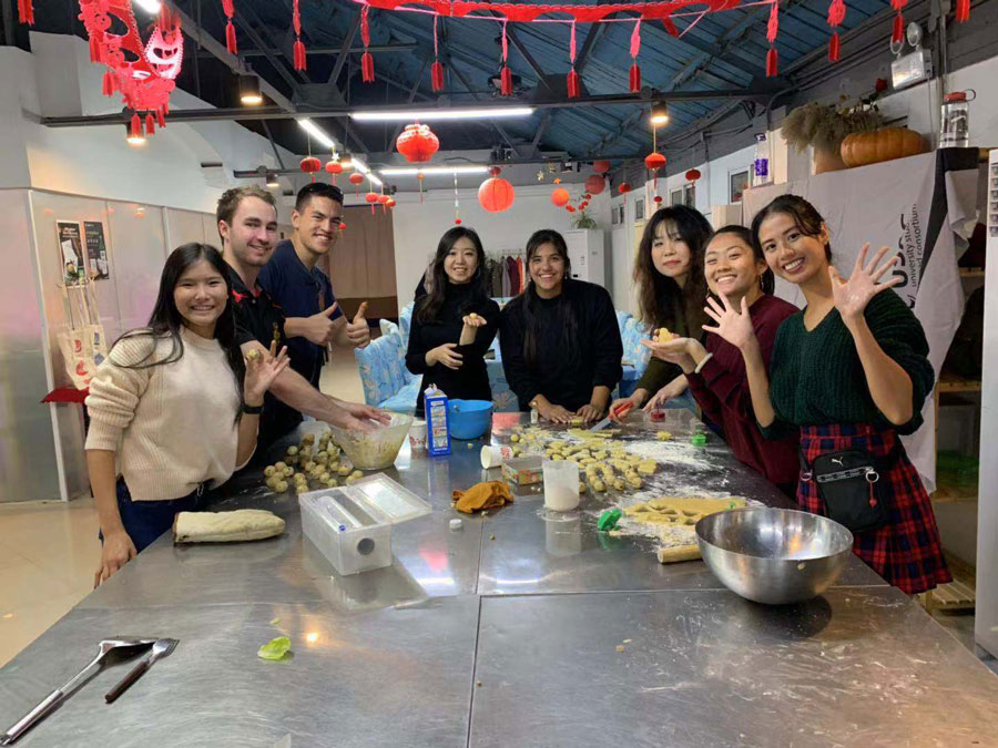 USAC students in Shanghai, China cook Thanksgiving dinner