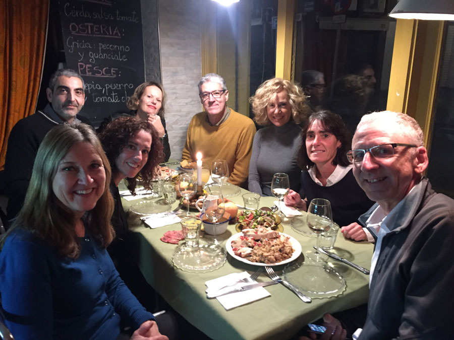 A group of people enjoying thanksgiving dinner in Valencia, Spain