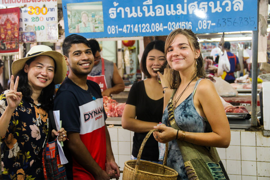 Students who are studying abroad gathered around a market in Shanghai, China