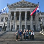 Students pose in front of popular building in Montevideo, Uruguay