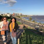 Two students studying abroad in Montevideo, Uruguay with the beach in the background.