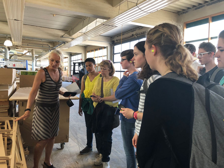 Students receive a factory tour of a sustainable business in Germany to learn about climate change