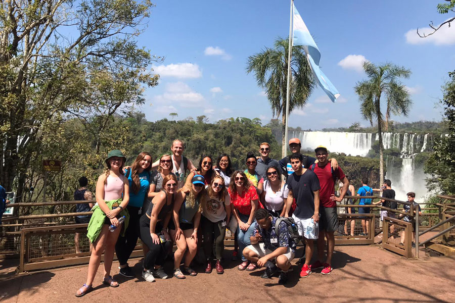 A group of students pose for a photo in Iguazu Falls. This is a field trip option when you study Latin Studies on USAC's new comparative studies program in Uruguay and Cuba for summer session.