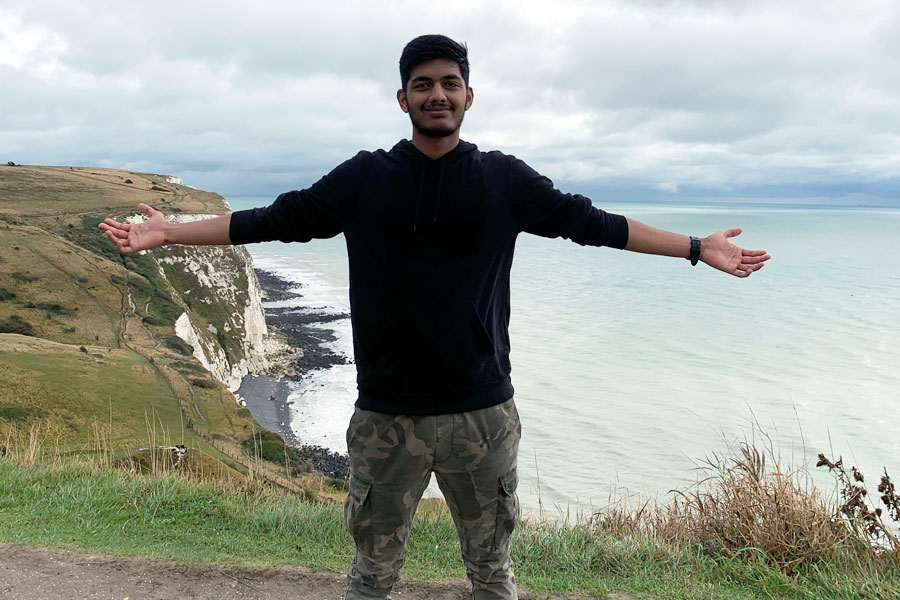 A student hiking in Dover during his study abroad in London with USAC