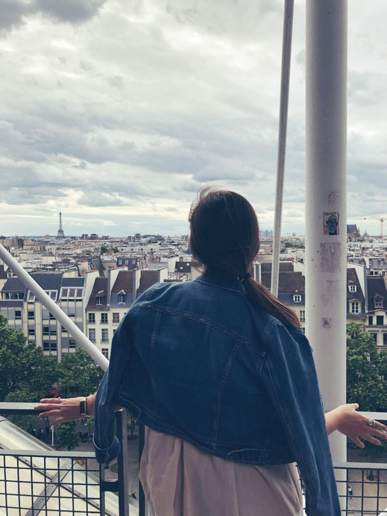 Student looks out over Paris during a study abroad in France