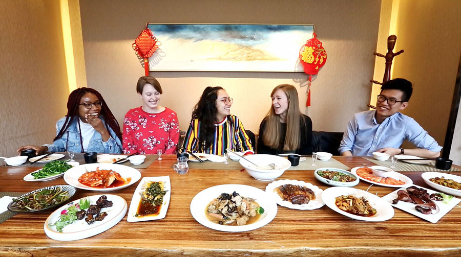 USAC students enjoy traditional chinese cuisine during study abroad in China