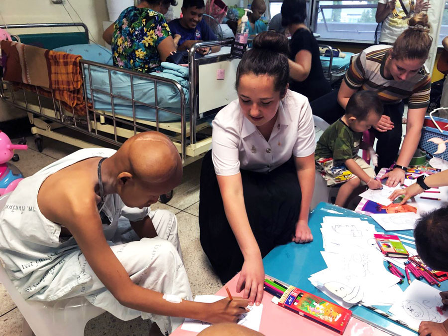 A student volunteers at a local hospital while studying health in Khoan Kaen, Thailand