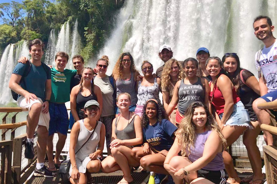 Students pose at Iguaca Falls in Brazil, during a summer study abroad